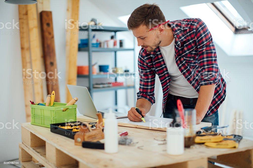 Furniture Designer working in His Workshop stock photo