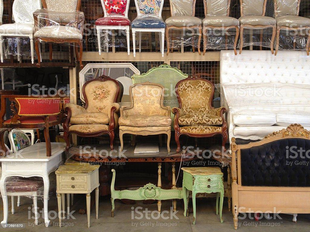 Furniture for sale at flea market stock photo