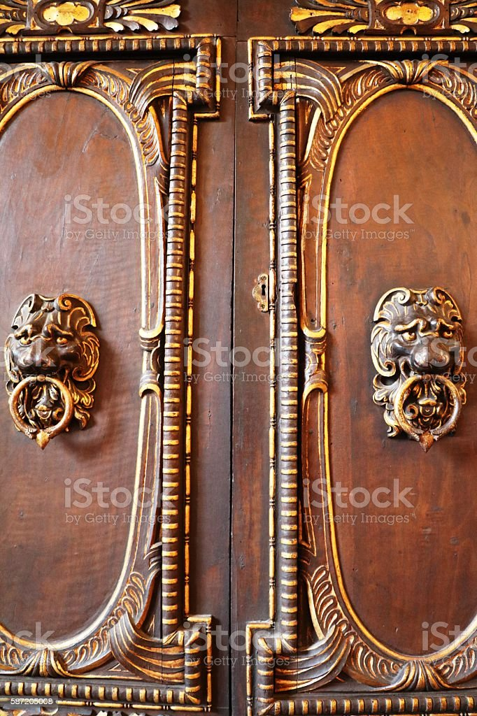 Furniture Handles lion heads on antique cupboard stock photo