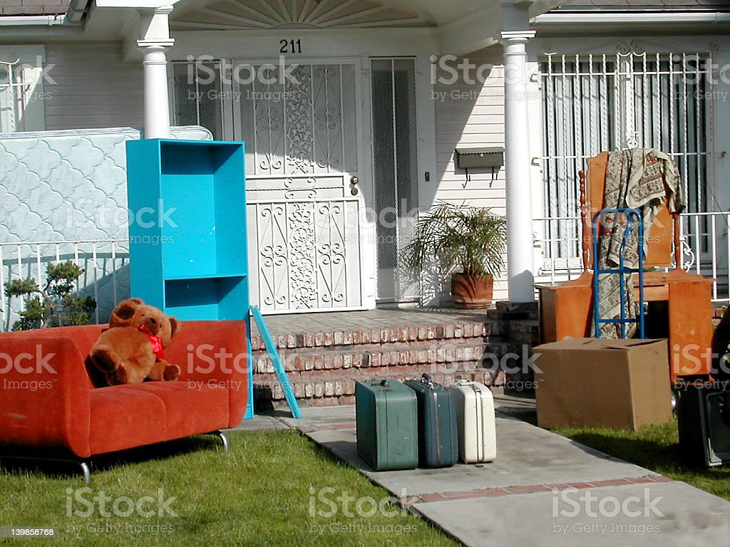 Furniture outside of a house signifying eviction stock photo