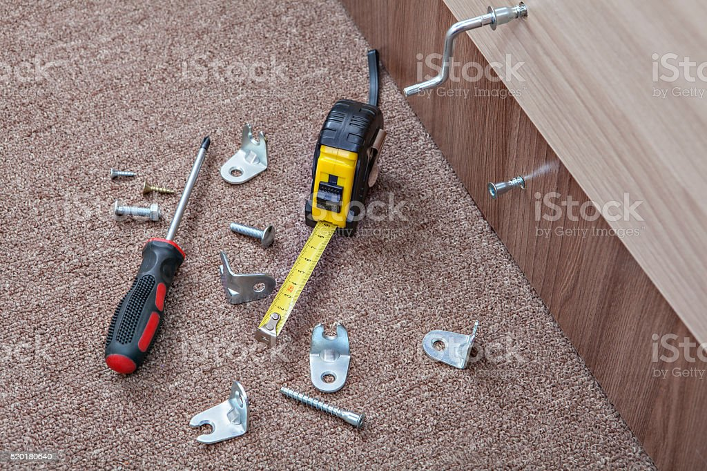 Furniture screws with crosshead screwdriver, tape measure, Hardware and Fasteners. stock photo