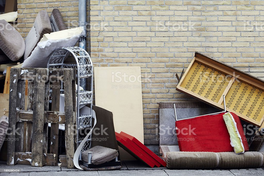 Furnitures thrown out on the street stock photo