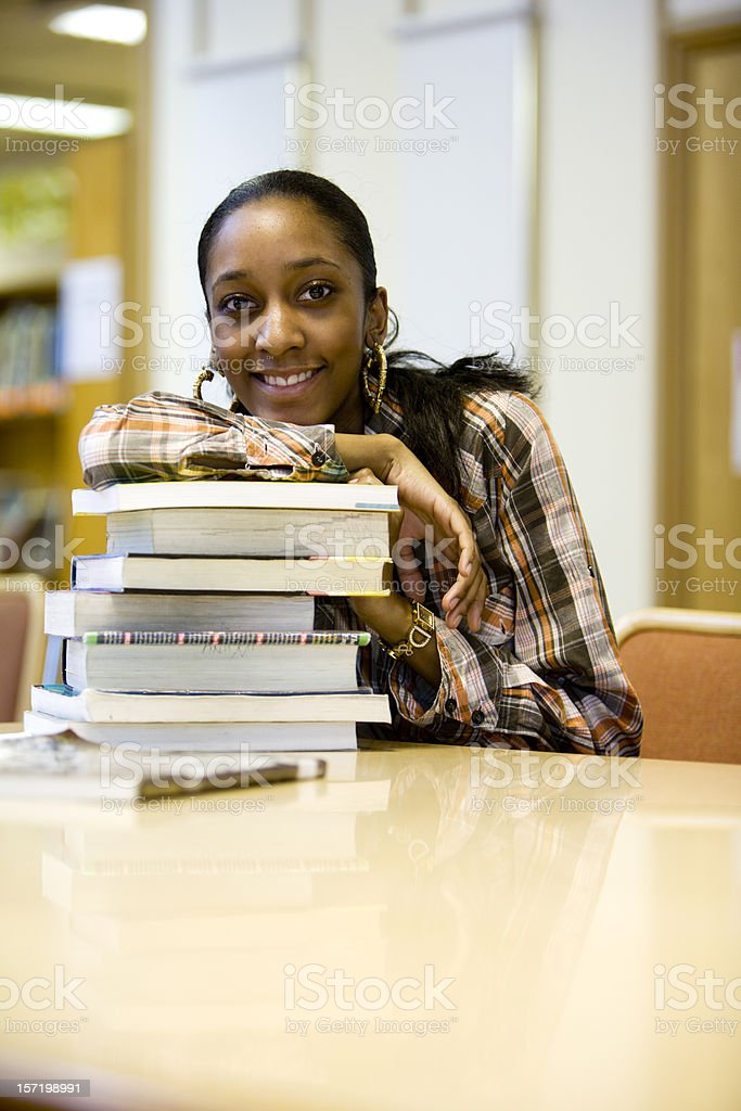 further education: a friendly female student with books royalty-free stock photo