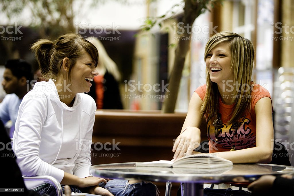further education: best friends sharing a laugh during break royalty-free stock photo