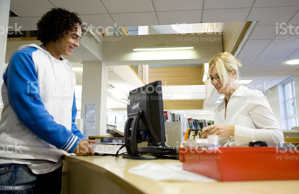 further education: borrowing books royalty-free stock photo