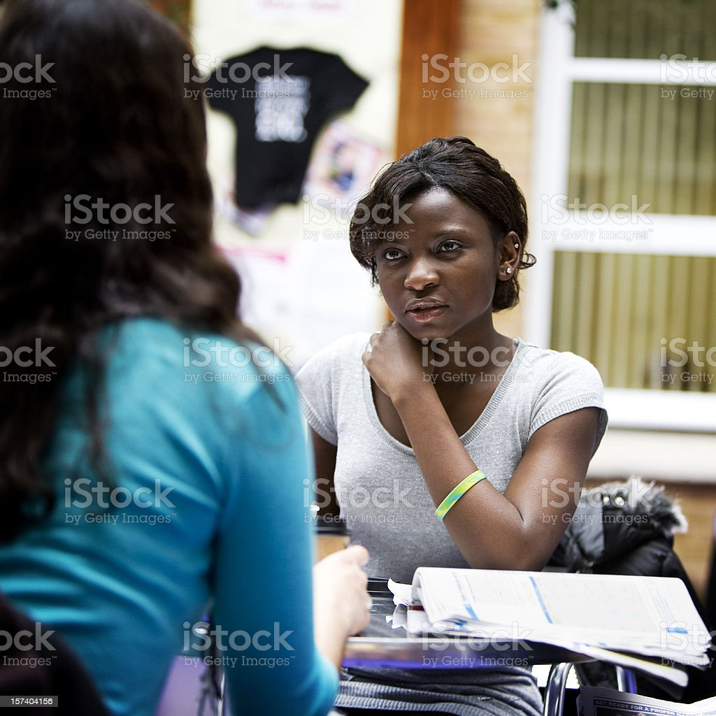 further education: candid concentration as school friends work together royalty-free stock photo