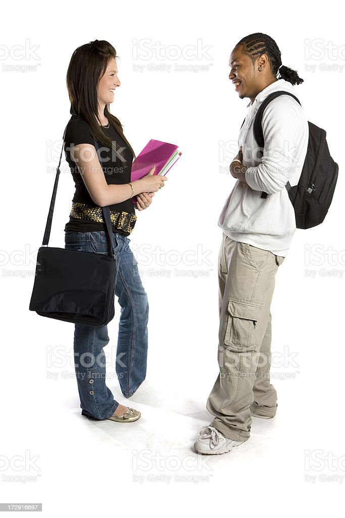 further education: candid friends talking about their class studies together stock photo