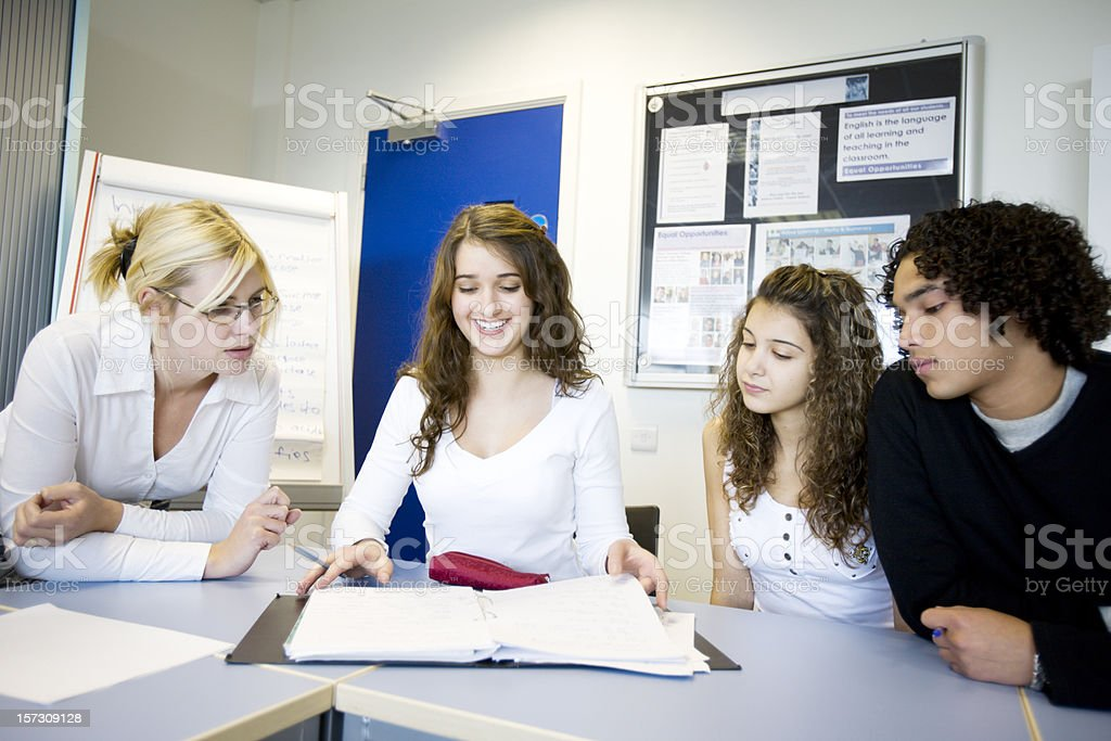 further education: class working together with their teacher royalty-free stock photo