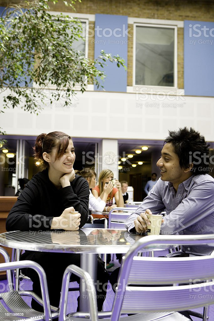 further education: coffee break for a pair of school friends royalty-free stock photo