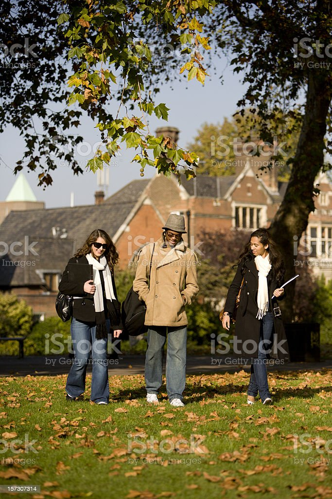 further education: cold, autumn scene with pupils walking to class royalty-free stock photo