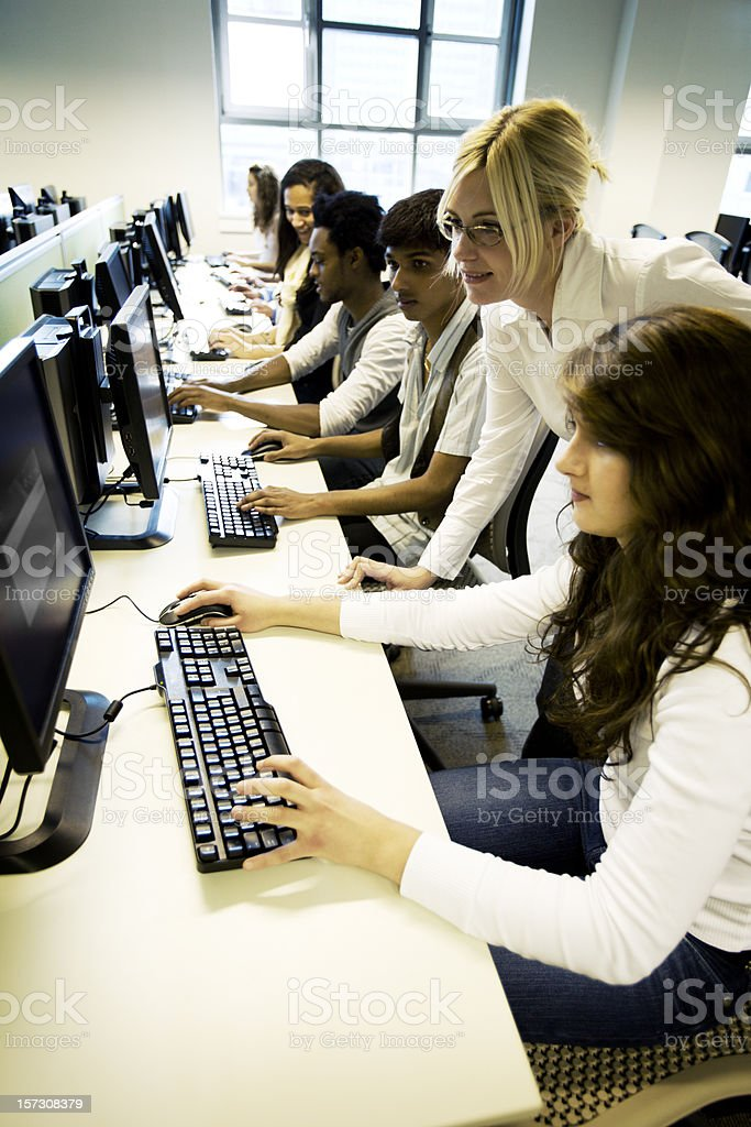 further education: computer studies with teacher supervision royalty-free stock photo