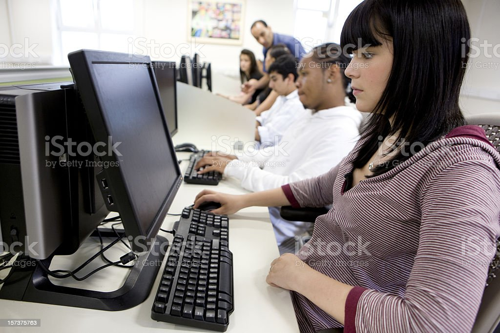further education: concentration on the faces of learners using computers royalty-free stock photo