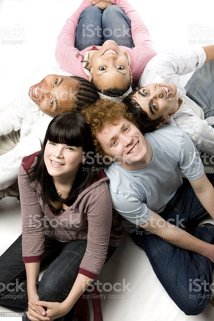 further education: diverse circle of carefree smiling friends looking up royalty-free stock photo