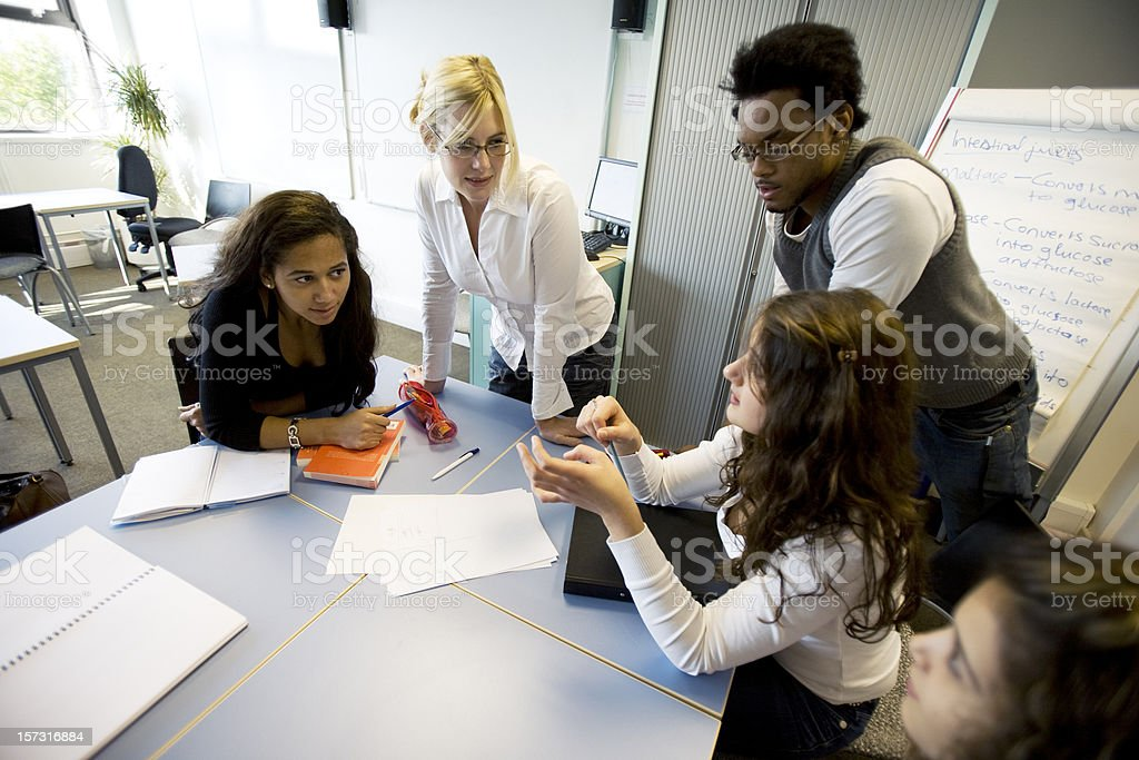 further education: diverse classmates problem solving in the classroom royalty-free stock photo