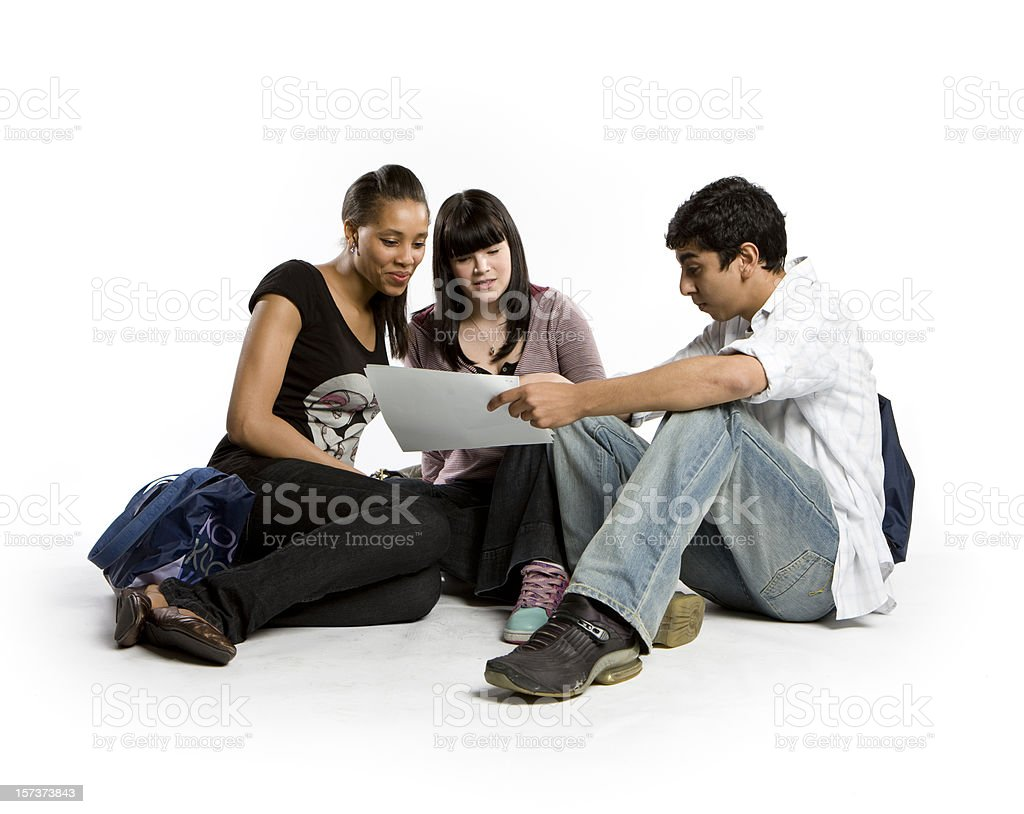 further education: diverse friends candidly comparing notes royalty-free stock photo