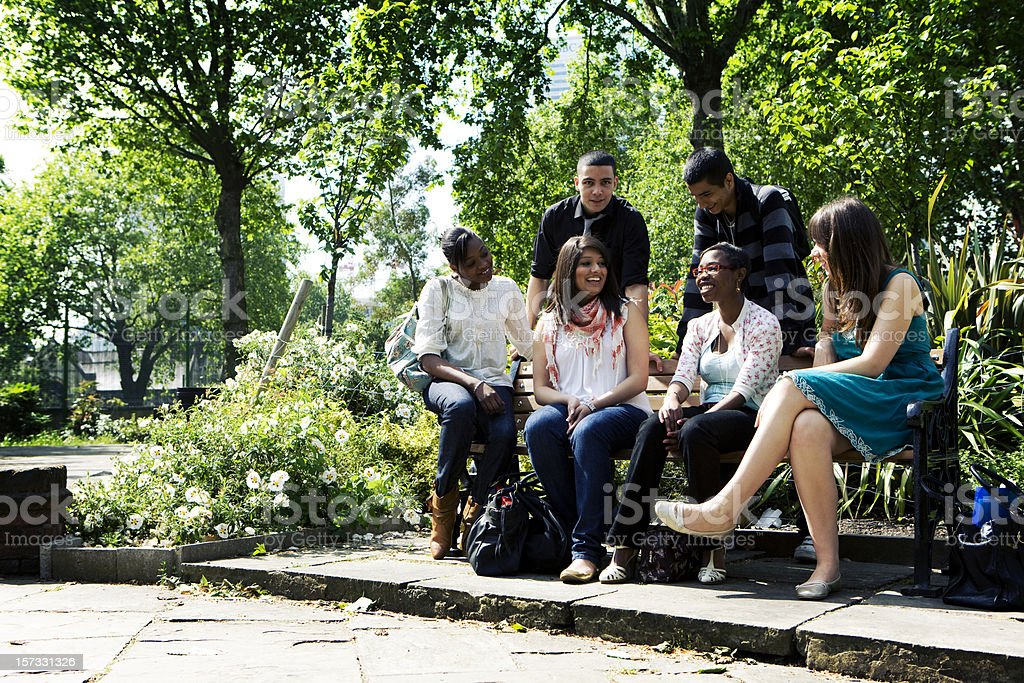 further education: diverse school friends relax between classes royalty-free stock photo