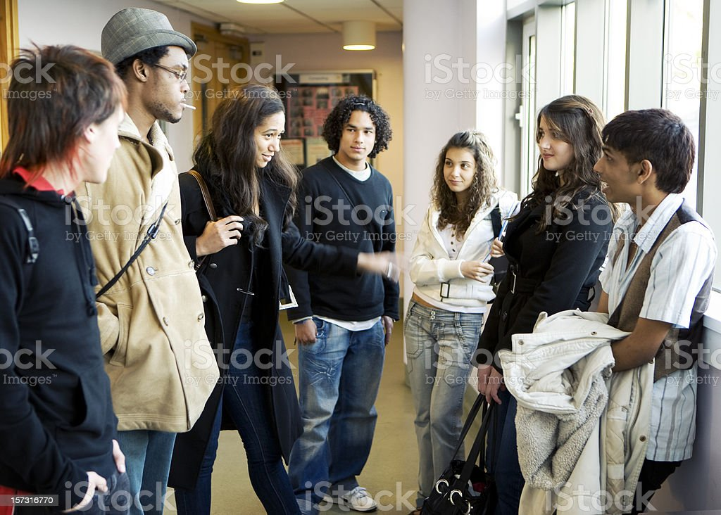 further education: diverse school friends waiting for class to begin stock photo