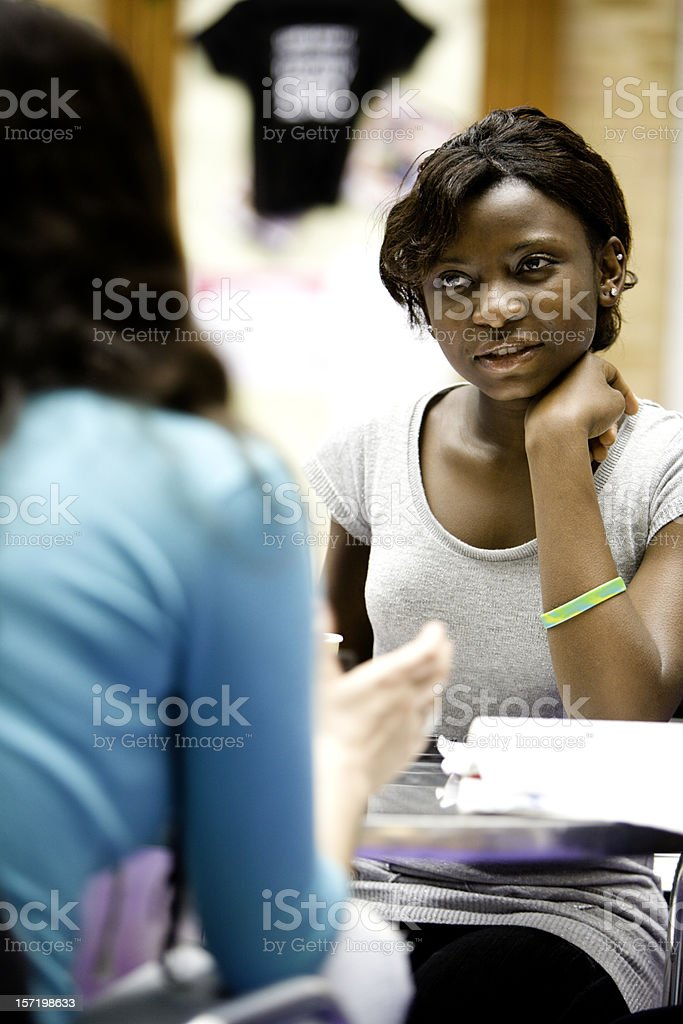 further education: Eye contact and concentration between teenage students royalty-free stock photo