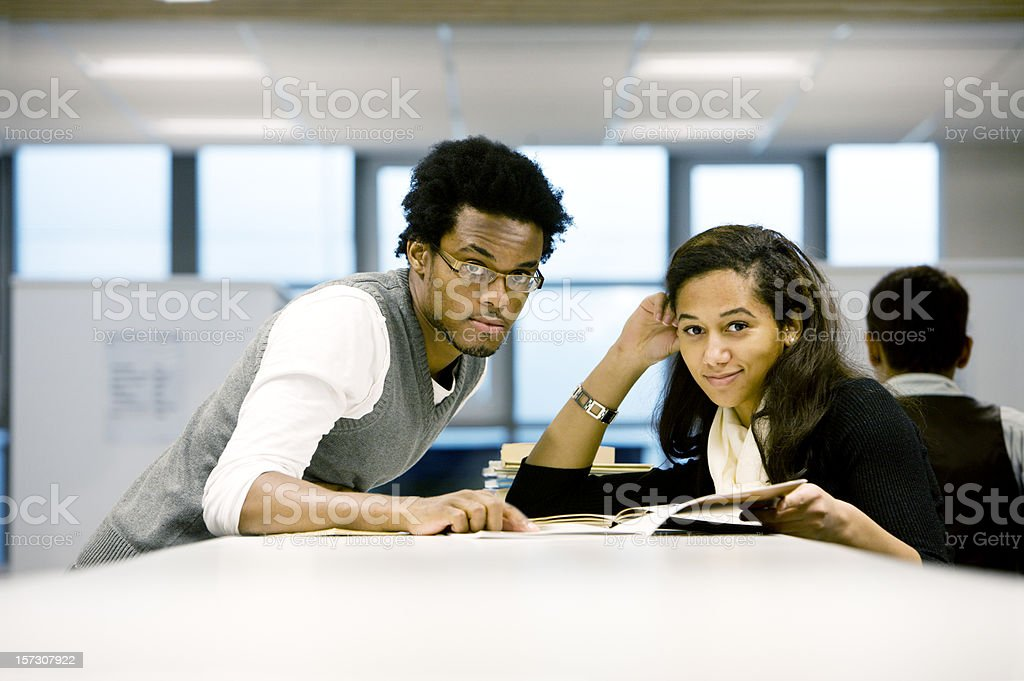 further education: eye contact from school friends working together royalty-free stock photo