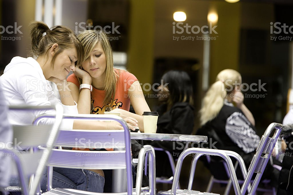further education: gossip between two girl friends during class break royalty-free stock photo