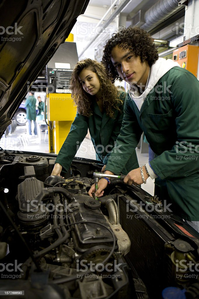further education: practical experience for engineering class in the garage royalty-free stock photo