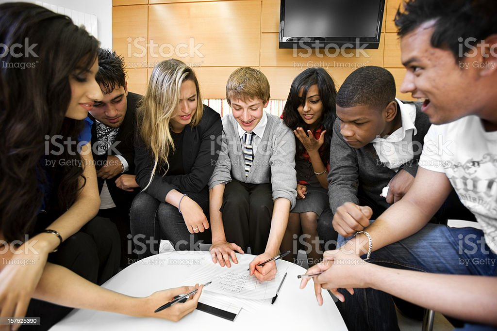 further education: project work for a group of diverse students royalty-free stock photo