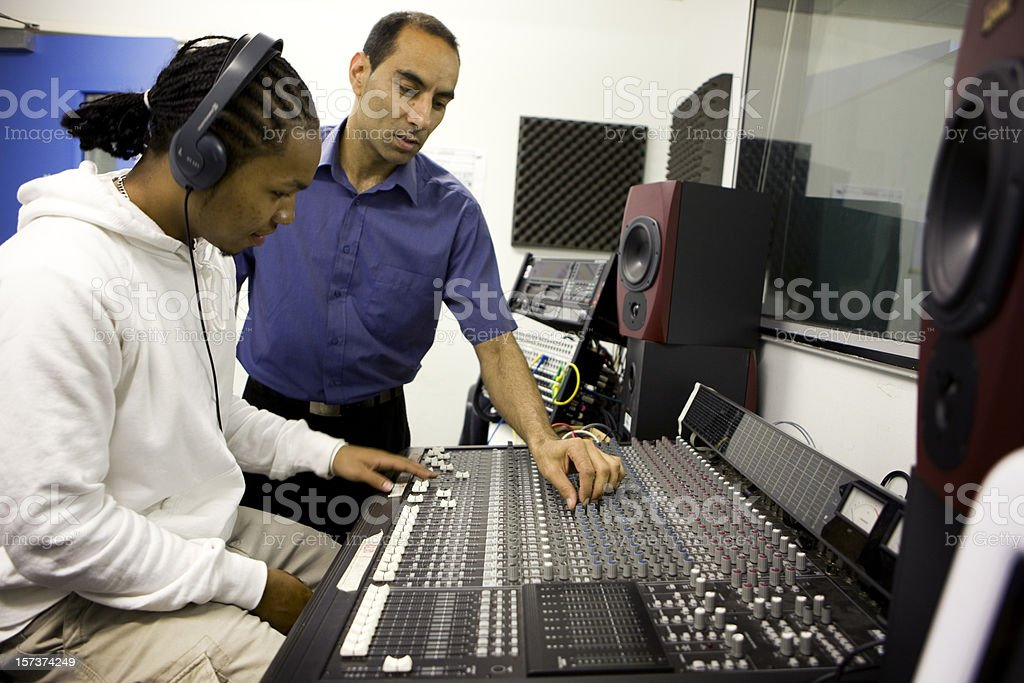 further education: teacher demonstrating music technology equipment to a pupil stock photo