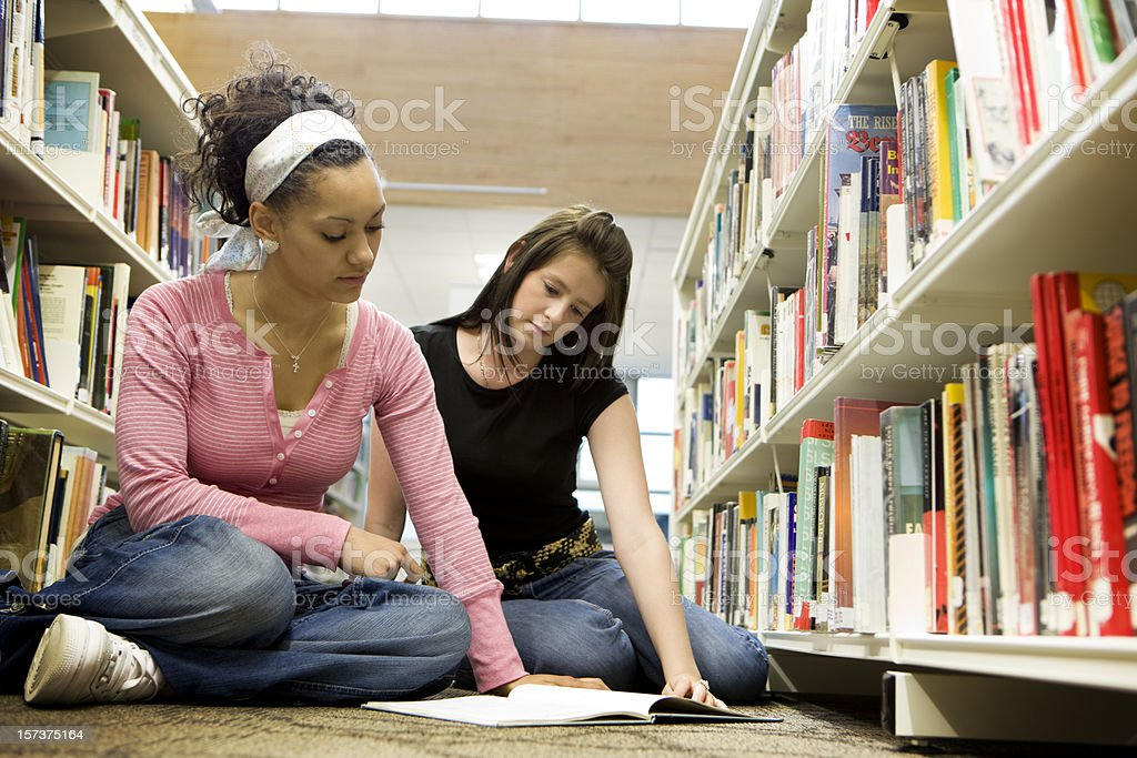 further education: teenage students using their college library for revision royalty-free stock photo