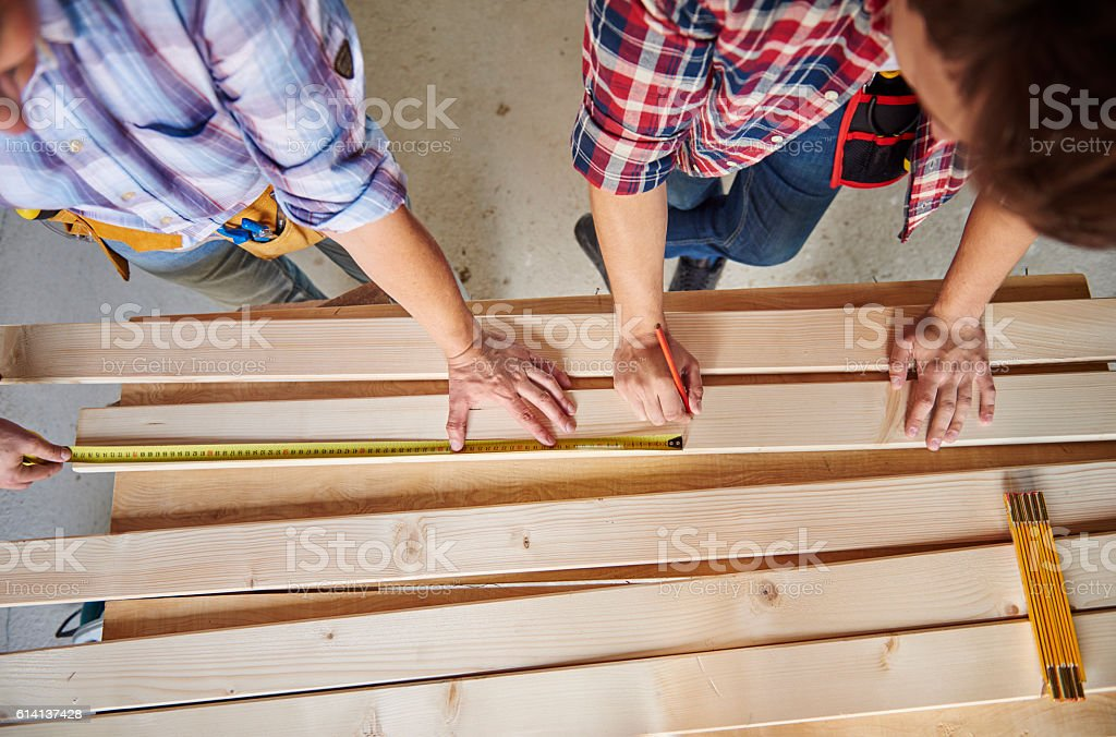Further measurement done by carpenters stock photo