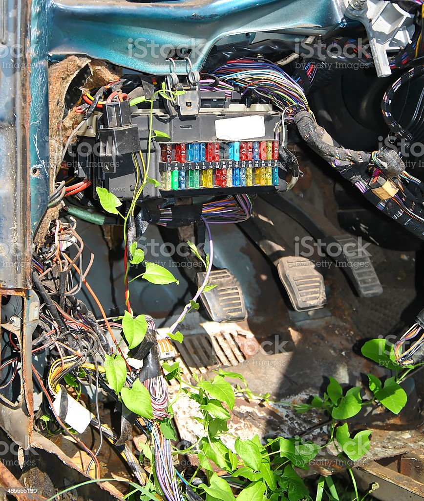 Fusebox in old car with bindweed wrapped around wires stock photo