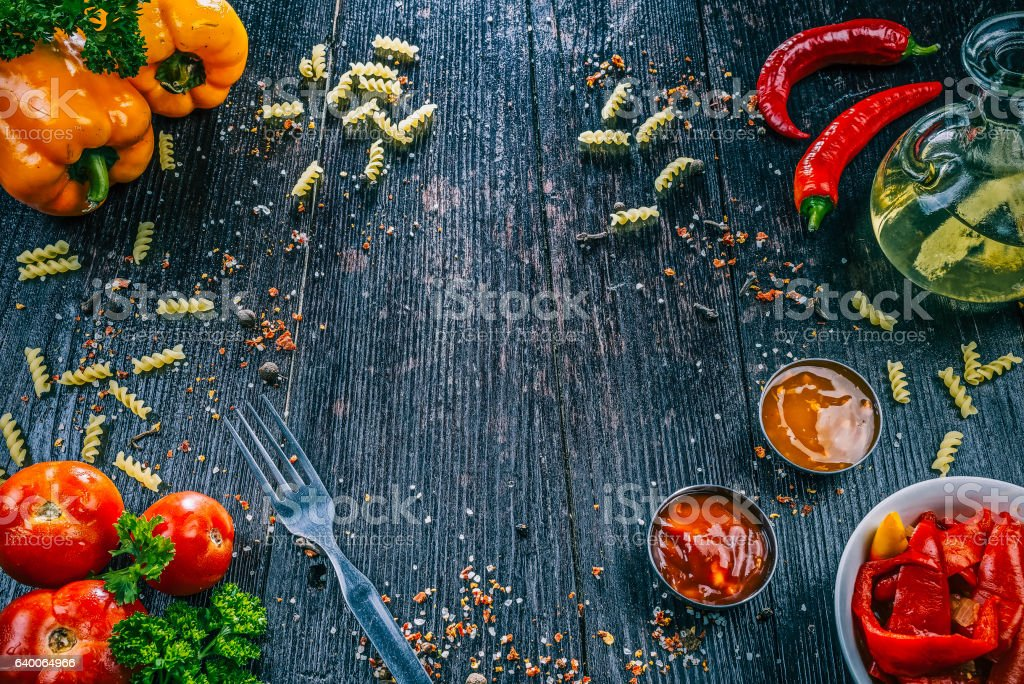 Fusilli and vegetable on dark wood stock photo