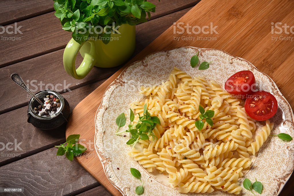 fusilli pasta on a plate stock photo