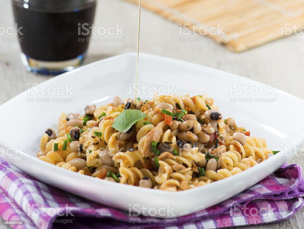 fusilli pasta with beans and tomato stock photo