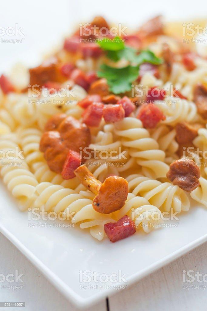 Fusilli pasta with mushrooms and bacon. stock photo