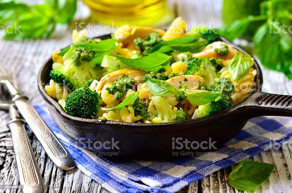 Fusilli with chicken,broccoli and basil pesto. stock photo