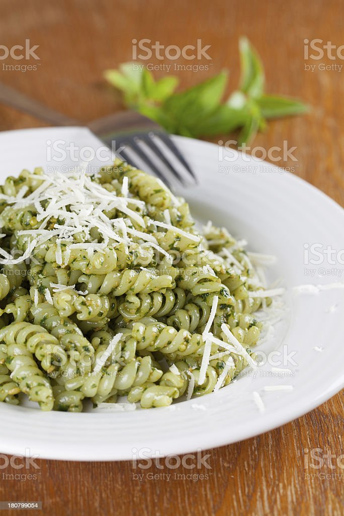 Fusilli with pesto and parmesan royalty-free stock photo