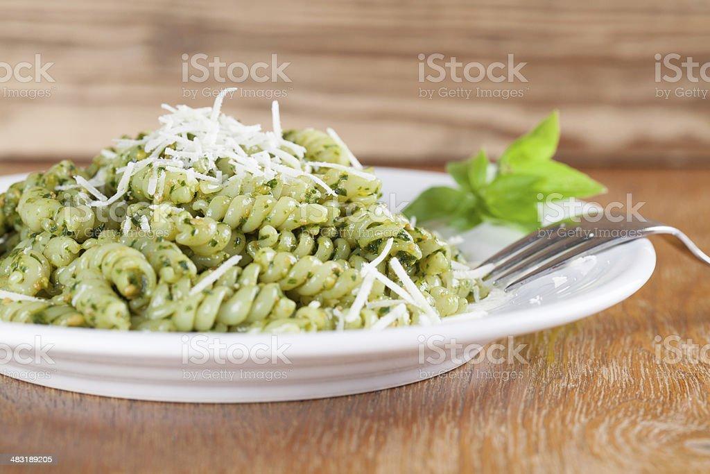 Fusilli with pesto and parmesan stock photo