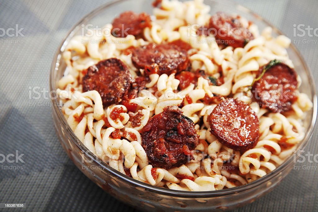 Fusilli with sausage, tomato sauce and parmesan royalty-free stock photo