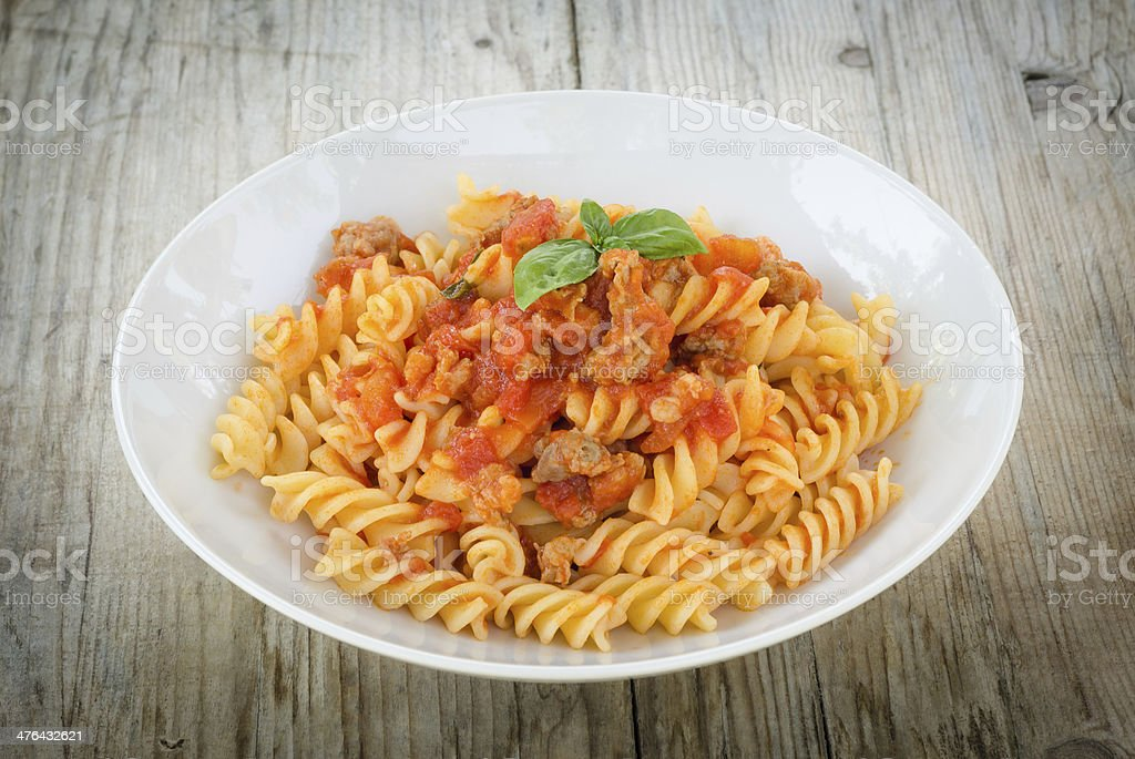 Fusilli with tomato and sausage stock photo