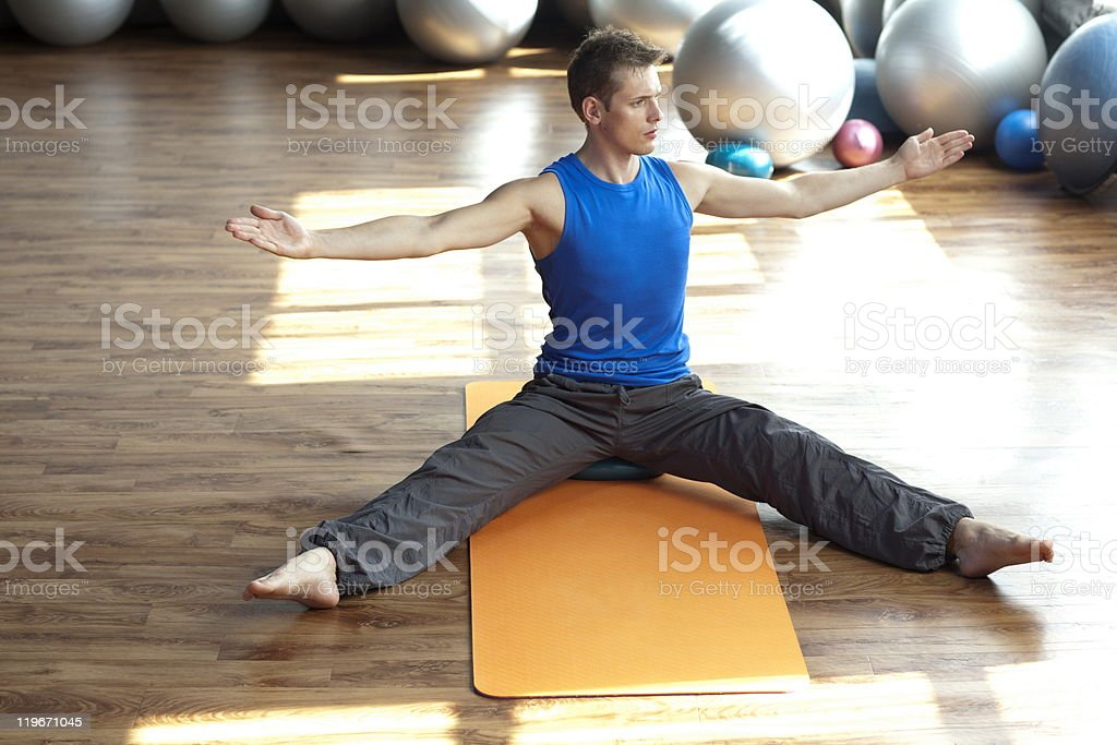 fusion of mind and body - man practicing pilates royalty-free stock photo