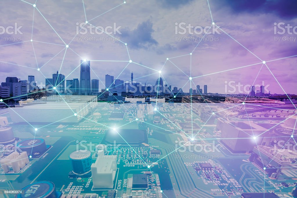 fusion of modern cityscape and electric circuit board stock photo