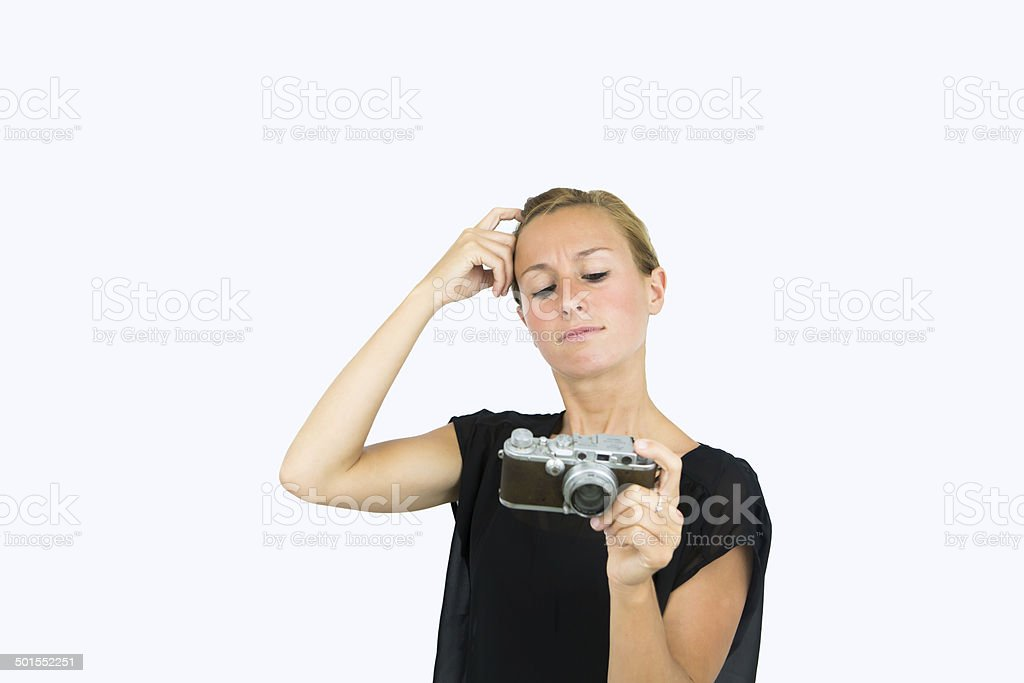 Fustrated woman with vintage camera stock photo