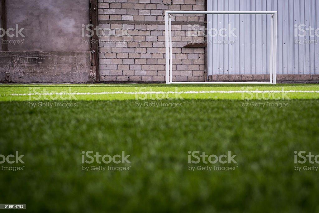futsal soccer goal post against a brickwall stock photo