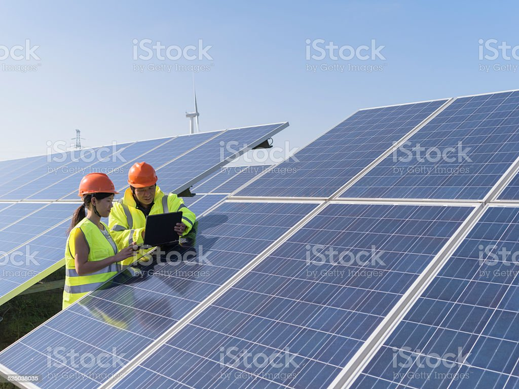 Future electrical production, asian engineers stock photo