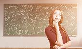 Future scientist girl in sunlit classroom