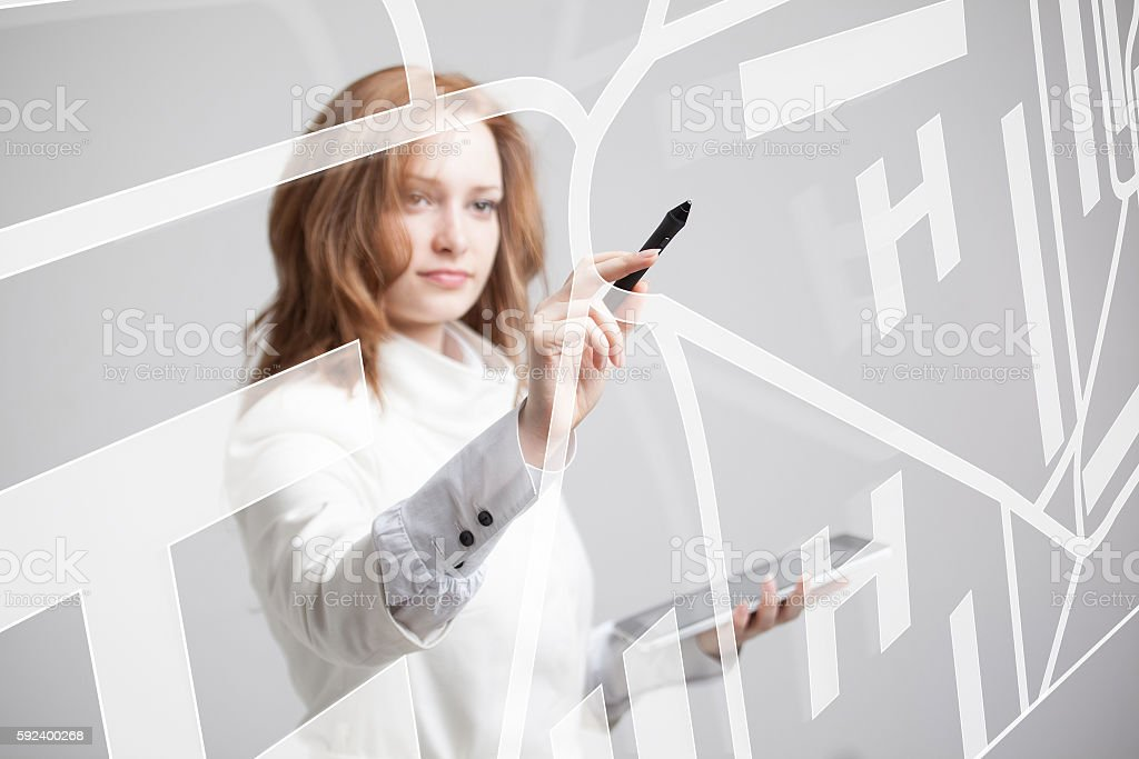 Future technology, navigation, location concept. Woman showing transparent screen with stock photo