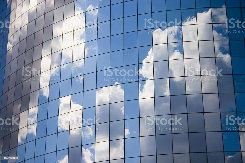 Futuristic abstract business background with reflected blue skies and clouds royalty-free stock photo