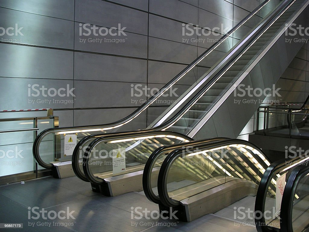 Futuristic and modern Escalator in glass & steel royalty-free stock photo