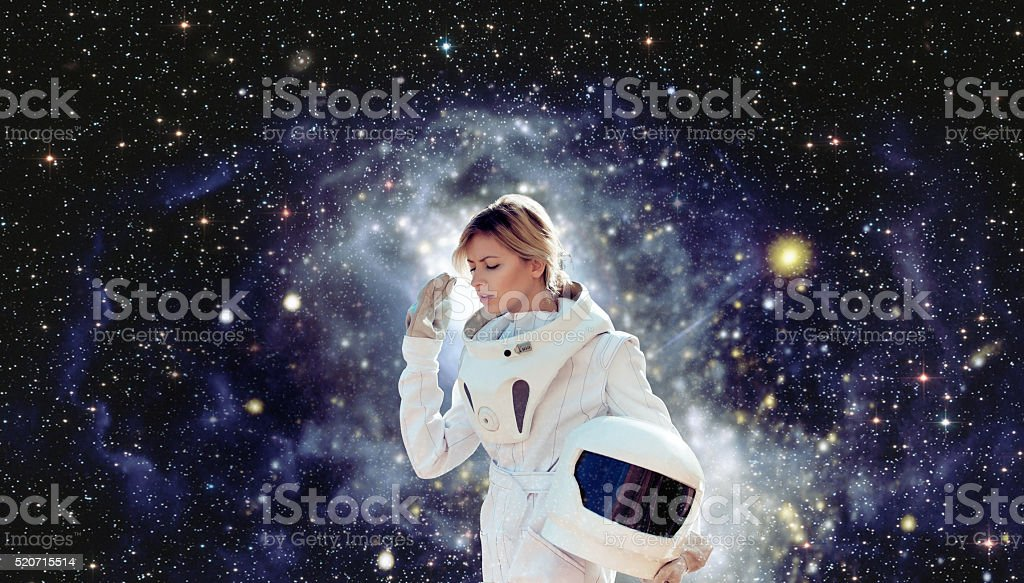 futuristic astronaut without  helmet,  space backgrounds. Elements of this image stock photo
