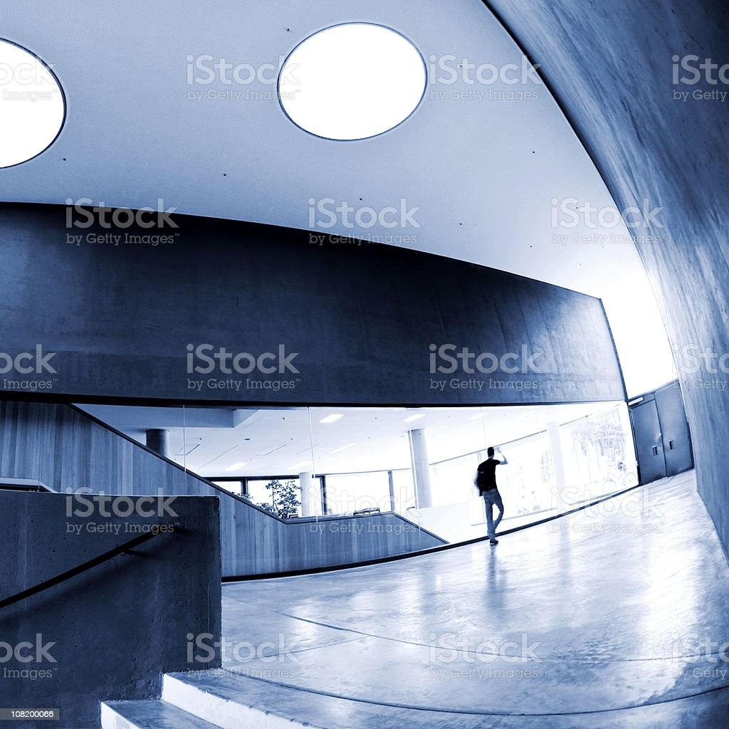 Futuristic Building with silhouette of person royalty-free stock photo